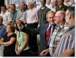 President George W. Bush greets the audience after delivering remarks on CAFTA-DR at Gaston College in Dallas, N.C., Friday, July 15, 2005.  White House photo by Eric Draper