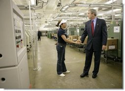 President George W. Bush greets a worker during a tour of R.I. Stowe Mills - Helms Plant in Belmont, N.C., Friday, July 15, 2005.  White House photo by Eric Draper