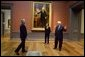 """President and Mrs. Bush receive a tour of the Gilbert Stuart Exhibition at the National Gallery of Art from Earl """"Rusty"""" Powell III, gallery director Monday, July 25, 2005, in Washington. White House photo by Krisanne Johnson"""