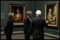 """President and Mrs. Bush receive a tour of the Gilbert Stuart Exhibition at the National Gallery of Art, from gallery director Earl """" Rusty"""" Powell III, Monday, July 25, 2005 in Washington. White House photo by Krisanne Johnson"""