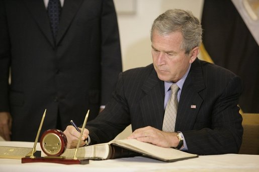 President George W. Bush signs the condolence book at the Egyptian Embassy, Monday, July 25. 2005 in Washington, expressing heart-felt sympathies for those who have lost their lives and were injured in the terror bombing in Sharm el-Sheikh, Egypt. White House photo by Eric Draper