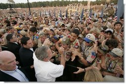 President George W. Bush greets some of the tens of thousands of Boy Scouts attending the 2005 National Scout Jamboree in Fort A.P. Hill, Va., Sunday, July 31, 2005.  White House photo by Paul Morse