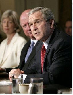 President Bush speaks to news reporters, Wednesday, July 13, 2005, prior to the start of a cabinet meeting at the White House. In background from left to right are cabinet members Secretary of Interior Gale Norton and Secretary of Energy Samuel W. Bodman.  White House photo by Eric Draper