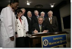 President George W. Bush signs the Patient Safety and Quality Improvement Act of 2005, at a signing ceremony Friday, July 29, 2005 at the Eisenhower Executive Office Building in Washington, D.C. White House photo by Eric Draper