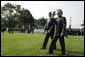President George W. Bush walks with India's Prime Minister Dr. Manmohan Singh , Monday, July 18, 2005, on the South Lawn of the White House, during Singh's official arrival ceremony. White House photo by David Bohrer
