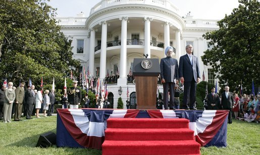 President Bush stands with India's Prime Minister Dr. Manmohan Singh, Monday, July 18, 2005 during the playing of the national anthems on the South Lawn of the White House. White House photo by Eric Draper
