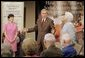 President George W. Bush appears with his mother Barbara Bush, and Medicare trainer Patty Patterson, Friday, July 22, 2005, at the Wesley Woods Center in Atlanta, to talk about new options in Medicare available to senior citizens. White House photo by Paul Morse