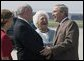President George W. Bush and his mother Barbara Bush are greeted by Georgia Governor Sonny Perdue, upon their arrival to Atlanta, Friday, July 22, 2005, to attend events to talk about Social Security and Medicare. White House photo by Paul Morse
