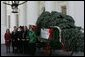 Laura Bush receives the official White House Christmas tree delivered on a horse drawn wagon Monday, Nov. 29. 2004. The 18.5 foot Noble fir donated by John and Carol Tillman of Rochester, Wash., will be decorated and displayed in the Blue Room. White House photo by Susan Sterner