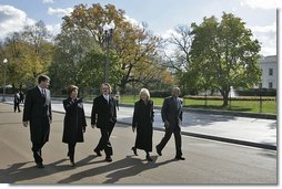 After speaking at the ceremonies in which Pennsylvania Avenue was opened as a pedestrian park, Laura Bush walks with, from left, Chairman of the National Capital Planning Commission John Cogbill; landscape architect Michael Van Valkenburgh; Federal Highway Administration Administrator Mary Peters; and Washington, D.C., Mayor Anthony Williams along Pennsylvania Avenue Tuesday, Nov. 9, 2004.  White House photo by Susan Sterner