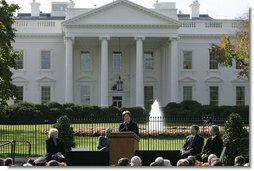 Laura Bush speaks during the opening ceremonies for Pennsylvania Avenue as a pedestrian park Tuesday, Nov. 9, 2004.  White House photo by Paul Morse