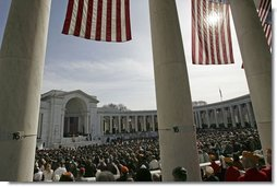 """President George W. Bush honors Veterans Day in a speech at Arlington National Cemetery Nov. 11, 2004. """"Twenty-five million military veterans walk among us, and on this day, our nation thanks them all,"""" said the President. """"These are the hidden heroes of a peaceful nation: our colleagues and friends, neighbors and family members who answered the call and returned to live in the land they defended."""" White House photo by Tina Hager"""