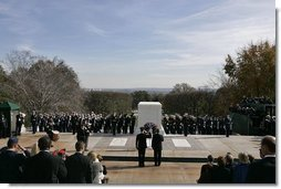 President George W. Bush visit the Tomb of the Unknowns at Arlington National Cemetery on Veterans Day Thursday, Nov. 11, 2004. After paying his respects, the President delivered remarks at the cemetery's amphitheater. White House photo by Paul Morse