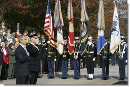 """President George W. Bush salutes the playing of the national anthem during a wreath laying ceremony at the Tomb of the Unknowns on Veterans Day Thursday, Nov. 11, 2004. """"Today we also recall the men and women who did not live to be called """"veterans,"""" many of whom rest in these hills. Our veterans remember the faces and voices of fallen comrades. The families of the lost carry a burden of grief that time will lighten, but never lift,"""" said the President in his remarks. White House photo by Paul Morse"""