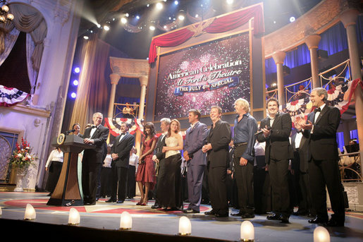 President George W. Bush and Mrs. Laura Bush are joined on stage by the cast of entertainers performing at the annual Ford's Theater gala to benefit the historic theater. The program,