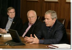 President George W. Bush gestures as he addresses his top advisors during an interagency team meeting on Iraq Monday, June 12, 2006 at Camp David, Md., part of a two-day conference on Iraq. Vice President Dick Cheney and National Security Council advisor Stephen Hadley are seen at left. White House photo by Eric Draper