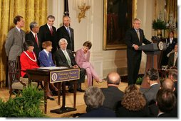 President George W. Bush addresses invited guests in the East Room of the White House prior to signing a proclamation to create the Northwestern Hawaiian Islands Marine National Monument, Wednesday, June 15, 2006.The proclamation will bring nearly 140,000 square miles of the Northwestern Hawaiian Island Coral Reef Ecosystem under the nation's highest form of marine environmental protection. Mrs. Laura Bush joined the President and distinguished guests on stage, seated from left to right, Hawaii Gov. Linda Lingle; marine biologist Sylvia Earle; and documentary filmmaker Jean-Michel Cousteau, Standing ,left to right, are U.S. Rep. Ed Case, D-Hawaii; U.S. Sen. Daniel Akaka, D-Hawaii; U.S. Commerce Secretary Carlos Gutierrez and U.S. Interior Secretary Dirk Kempthorne. White House photo by Shealah Craighead