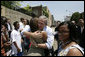 President George W. Bush embraces a young woman and meets other visitors outside the National Civil Rights Museum, Friday, June 30, 2006 in Memphis, where President Bush was joined by Mrs. Laura Bush and Japan's Prime Minister Junichiro Koizumi on a tour of the site where civil rights leader Dr. Martin Luther King, Jr. was assassinated in 1968. White House photo by Eric Draper