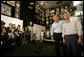 President George W. Bush and Japanese Prime Minister Junichiro Koizumi gaze at the awards that decorate the Racquetball Room during a tour of Graceland, the home of Elvis Presley, given by his former wife Priscilla Presley and their daughter Lisa-Marie Presley, Friday, June 30, 2006, in Memphis. White House photo by Shealah Craighead