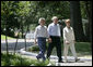 President George W. Bush, Laura Bush and Japanese Prime Minister Junichiro Koizumi, wearing a pair of Elvis-style sunglasses, tour the grounds of Graceland, the home of Elvis Presley, Friday, June 30, 2006 in Memphis. White House photo by Eric Draper