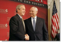 """President George W. Bush is introduced by former Secretary of State Colin Powell at the Initiative for Global Development's 2006 National Summit in Washington, D.C., Thursday, June 15, 2006. """"We have a moral duty to care for those who hurt here at home, and we have a moral duty to care for those as best as we can for those abroad, said the President. """"That's part of the foreign policy of our country."""" White House photo by Kimberlee Hewitt"""