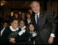 President George W. Bush poses with a group of young children Thursday morning, June 8, 2006, following his address at the National Hispanic Prayer Breakfast in Washington. White House photo by Kimberlee Hewitt