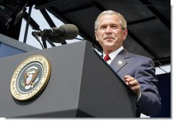 """President George W. Bush delivers the commencement address during the graduation ceremony at the United States Merchant Marine Academy at Kings Point, New York, Monday, June 19, 2006. """"In times of peace, the Merchant Marine helps ensure our economic security by keeping the oceans open to trade,"""" said the President. """"In times of war, the Merchant Marine is the lifeline of our troops overseas, carrying critical supplies, equipment, and personnel.""""  White House photo by Kimberlee Hewitt"""