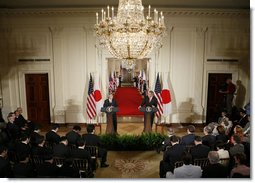 President George W. Bush and Japan's Prime Minister Junichiro Koizumi are seen at their joint press availability Thursday, June 29, 2006, in the East Room of the White House. White House photo by Paul Morse