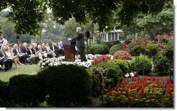 President George W. Bush speaks with reporter's Wednesday morning, June 14, 2006, during a news conference in the Rose Garden, following his trip to Iraq where he met with members of the Iraq government and U.S. troops. White House photo by Paul Morse