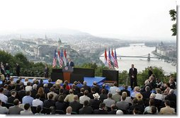 """President George W. Bush speaks from Gellert Hill in Budapest, Hungary, Thursday, June 22, 2006. """"From this spot you could see tens of thousands of students and workers and other Hungarians marching through the streets,"""" said President Bush in his remarks about the 1956 Hungarian uprising. """"They called for an end to dictatorship, to censorship, and to the secret police. They called for free elections, a free press, and the release of political prisoners. These Hungarian patriots tore down the statue of Josef Stalin, and defied an empire to proclaim their liberty."""" White House photo by Paul Morse"""