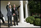 President George W. Bush and Prime Minister Junichiro Koizumi of Japan wave from the steps of the Rose Garden before meeting in the Oval Office Thursday, June 29, 2006 White House photo by Eric Draper