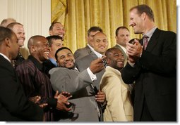 Pittsburgh Steeler Jerome Bettis, center, joins his teammates in a humorous moment with their coach Bill Cowher as the Super Bowl Champion Pittsburgh Steelers are honored at the White House, Friday, June 2, 2006, during a ceremony in the East Room. White House photo by Eric Draper