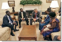 President George W. Bush meets with the National Endowment for Democracy award recipients in the Oval Office Tuesday, June 27, 2006. From left, they are Alfred Taban of Sudan, Dr. Reginald Matchaba-Hove of Zimbabwe, Immaculee Birhaheka of the Democratic Republic of the Congo and Zainab Hawa Bangura of Sierra Leone. White House photo by Kimberlee Hewitt