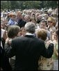 President George W. Bush meets some of the hundreds of family and friends who gathered on the South Lawn of the White House, Friday, Sept. 9, 2005, during the 9/11 Heroes Medal of Valor Award ceremony, in honor of the courage and commitment of emergency services personnel who died on Sept. 11, 2001. White House photo by Eric Draper