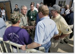 President George W. Bush speaks with Texas officials following a meeting about hurricane Rita at South Texas Regional Airport in Beaumont, Texas, Tuesday, Sept. 27, 2005.  White House photo by Eric Draper