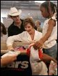 Laura Bush meets with people while visiting a clothing distribution site at the Biloxi Community Center, Tuesday, Sept. 27, 2005 in Biloxi, Miss., where she also interviewed with the television program, ABC's Extreme Makeover: Home Edition. White House photo by Krisanne Johnson