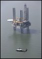 Marine One, carrying President George W. Bush, flies past an oil rig in the Gulf of Mexico near Cameron, La., during an aerial tour Tuesday, Sept. 27, 2005, of recent hurricane damage. White House photo by Eric Draper