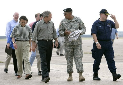 President George W. Bush speaks with Lt. Gen. Russel Honore after arriving Tuesday, Sept. 27, 2005, in Lake Charles, La., for a meeting with state officials. With them are Lake Charles Mayor Randy Roach, left, and U.S. Coast Guard Vice Admiral Thad Allen. White House photo by Eric Draper