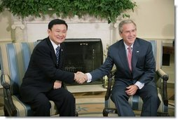 President George W. Bush shakes hands with Thailand's Prime Minister Thaksin Shinawatra, during a visit to the Oval Office at the White House, Monday, Sept. 19, 2005 in Washington.  White House photo by Eric Draper