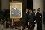 President George W. Bush and Laura Bush walk with Justice Antonin Scalia and Sally Rider, the Chief Justice's assistant, after viewing a portrait of Chief Justice William Rehnquist as his body lies in repose in the Great Hall of the U.S. Supreme Court Tuesday, Sept. 6, 2005. White House photo by Eric Draper