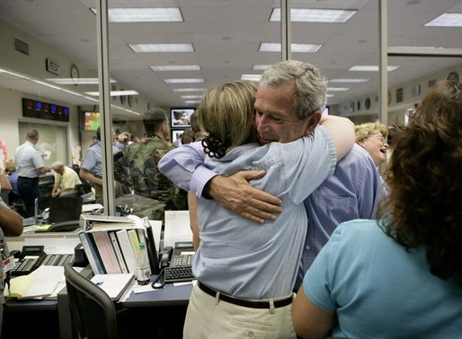 President George W. Bush hugs a worker while visiting with emergency personnel inside the Texas Emergency Operations Center in Austin, Texas, Saturday, Sept. 24, 2005. White House photo by Eric Draper