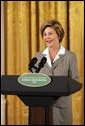 """Laura Bush speaks at the National Book Festival Author's breakfast in the East Room, Saturday, Sept. 24, 2005. """"Great books have brought many people through difficult times,"""" said Mrs. Bush, explaining that the Book Festival is collecting books for schools, libraries and those affected by the recent hurricanes. """"A story's setting -- real or imagined -- can provide a much-needed escape. And the characters in a good book are like old friends by the time we turn the final page."""" White House photo by Krisanne Johnson"""