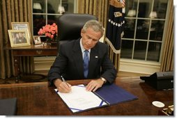 President George W. Bush signs legislation in the Oval Office Friday, Sept. 2, 2005, to provide 10.5 billion dollars in relief aid for the areas along the Gulf Coast affected by Hurricane Katrina. Congress approved the bill late Thursday.  White House photo by Paul Morse