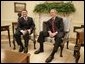 President George W. Bush visits with King Abdullah of Jordan, Thursday, Sept. 22, 2005 in the Oval Office at the White House in Washington. White House photo by Eric Draper