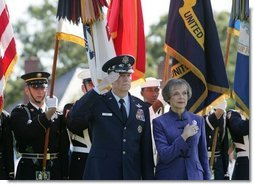 General Richard B. Myers salutes as he stands with his wife, Mary Jo Myers, Friday, Sept. 30, 2005, during ceremonies at theThe Armed Forces Farewell Tribute in Honor of General Richard B. Myers and the Armed Forces Hail in Honor of General Peter Pace at Fort Myer's Summerall Field in Ft. Myer, Va. White House photo by David Bohrer