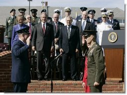 General Richard B. Myers, left, swears-in General Peter Pace, Friday, Sept. 30, 2005, as the new Chairman of the Joint Chiefs of Staff, during The Armed Forces Farewell Tribute in Honor of General Myers and the Armed Forces Hail in Honor of General Pace at Fort Myer's Summerall Field in Ft. Myer, Va., with President George W. Bush, Defense Secretary Donald Rumsfeld looking on. White House photo by Shealah Craighead