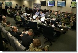 President George W. Bush receives a briefing with personnel from all branches of the military on Hurricanes Katrina and Rita inside NORAD's United States Northern Command in Colorado Springs, Colorado, Saturday, Sept. 24, 2005. White House photo by Eric Draper