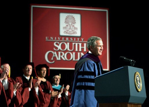 """President George W. Bush discusses peace in the Middle East during his Commencement Address at the University of South Carolina in Columbia, S.C., Friday, May 9, 2003. """"Across the globe, free markets and trade have helped defeat poverty, and taught men and women the habits of liberty,"""" said the President. """"So I propose the establishment of a U.S.-Middle East free trade area within a decade, to bring the Middle East into an expanding circle of opportunity, to provide hope for the people who live in that region."""" White House photo by Tina Hager"""