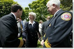 Interior Secretary Gale Norton greets firefighters after the President's remarks on his Healthy Forests Initiative in The East Garden Tuesday, May 20, 2003.  White House photo by Susan Sterner