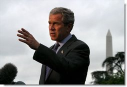 Departing the White House via Marine One, President George W. Bush talks with the media on the South Lawn Friday, May 16, 2003.  White House photo by Paul Morse